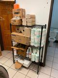 Shelf Full of Janitorial Supplies: Tork Paper Towels, Toilet Paper, Kay Cleaners, Trash Liners, Soap