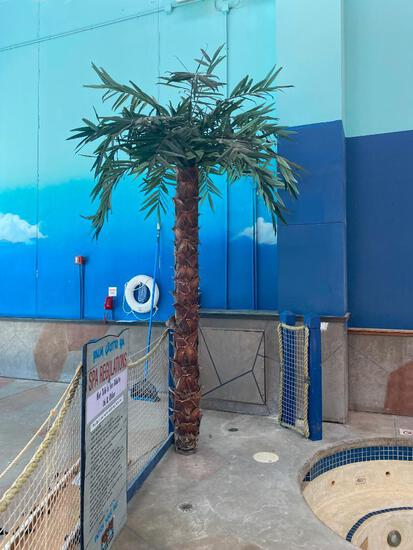 Two Artificial Palm Trees and an Artificial Plant