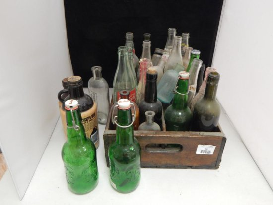 lot of vintage glass bottles in antique wood crate