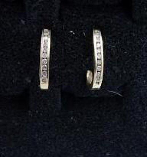 14kt gold diamond pendant earrings.