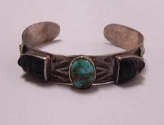 STERLING BRACELET WITH 3 STONES: 1 TURQUOISE STONE AND 2 BLACK STONES ON EITHER SIDE