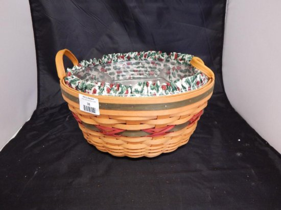 Longaberger 1999 Holiday Hostess Pinecone Basket, with two leather handles, fabric liner and 2
