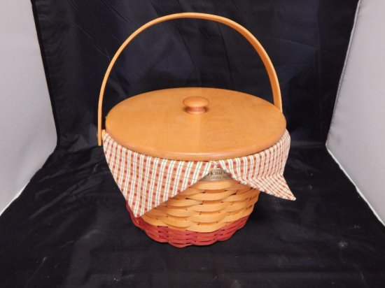 Longaberger 1999 Homestead Basket with movable handle, lid, fabric lining, and plastic protector