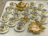 Group of Gold Finish Dishware Including Tea