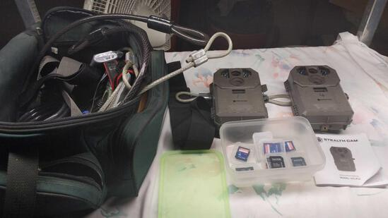 Pair of Stealth Cameras with bag, discs & cables