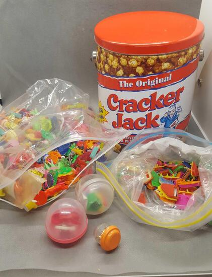 Cracker jack tin with 2 bags of charms