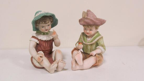 Pair of bisque piano babies 12.25""