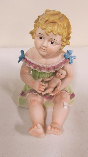 Bisque piano baby - girl holding baby