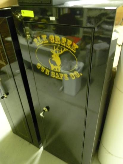 "Locking Elk Creek gun cabinet with keys 22""W x 55""H x 16""D"