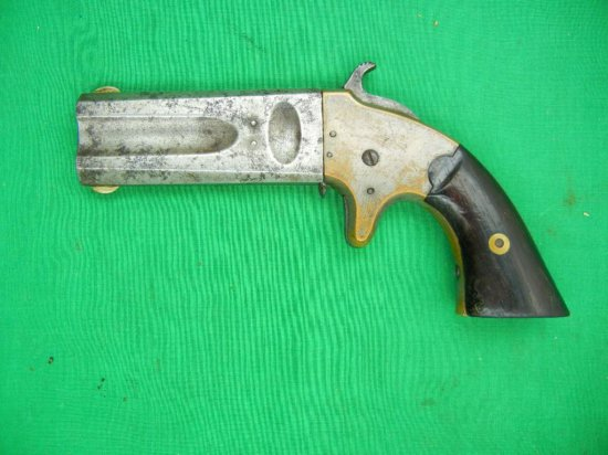 Manufacturer: American Arms Co. Model: Double Barrel Derringer Year: 1865-1866 Caliber: .22 and .32