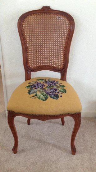 French chair with caned back and tapestry seat.