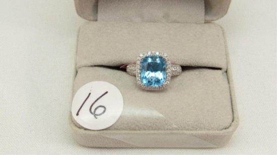 14K w/g 4.94ct Blue Topaz Ring with .65ct t.w. dia