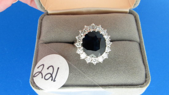 14K w/g sapphire center ring  surround by