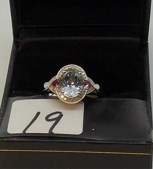 LADIES 10K W/G OVAL BLUE TOPAZ CENTER .14CT T.W. DIAMOND