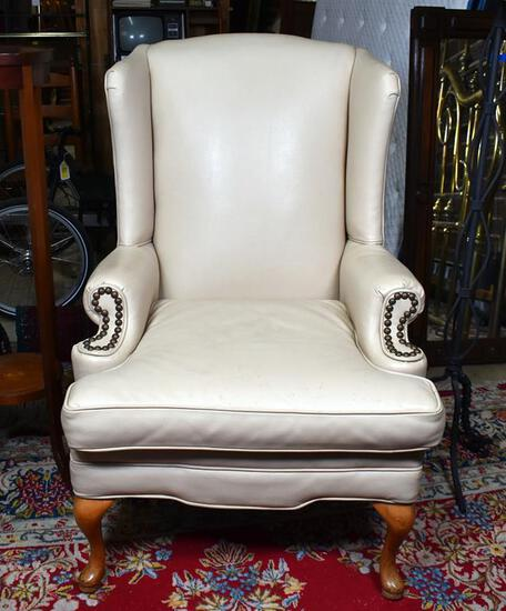 Handsome Cream or Light Tan Leather Wing Chair
