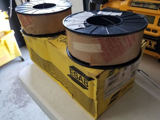 1 BOX AND 2 ROLLS OF WELDING WIRE