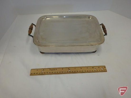 Silver chafing dish with bottom of sad iron used as heating element