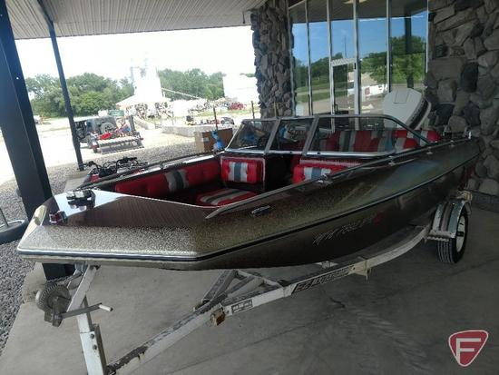 1982 Baja 160BR speedboat with 115HP Johnson outboard, ski pole, and 1982 EZ Loader trailer