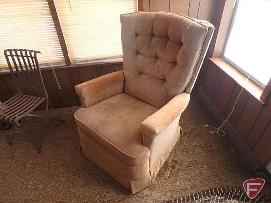 Upholstered recliner armchair