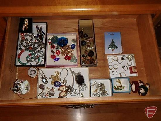 Jewellery: bracelets, lapel pins, necklaces, rings, earrings, metal compact, and watches