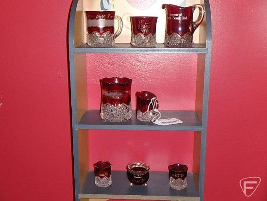 Ruby glassware, most with advertising: cream pitchers, mugs, toothpick holders, South Bend Indiana