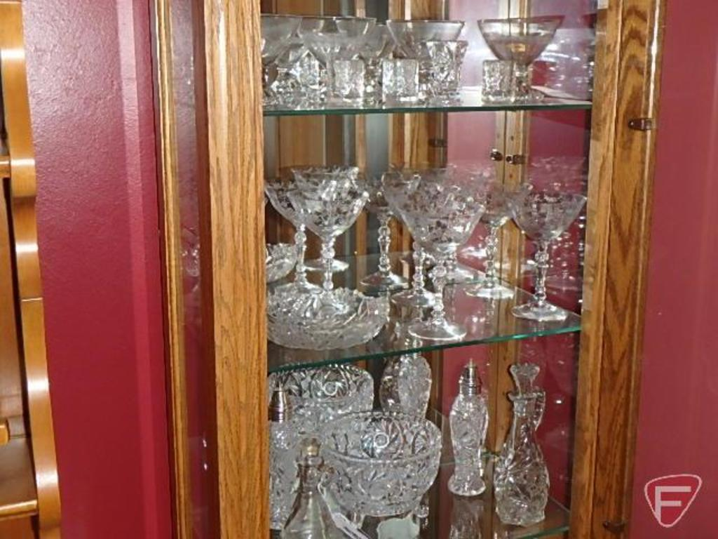 Clear glass stemware, salt and pepper, vinegar cruets; 3 shelves