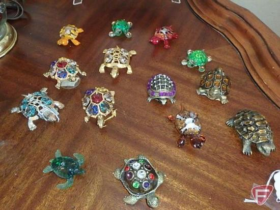 Small ornate turtles, lamp and decorative craft marbles in glass jar and Sharp clock