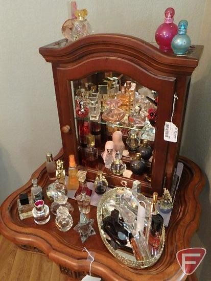 Perfume collection in cabinet and around it