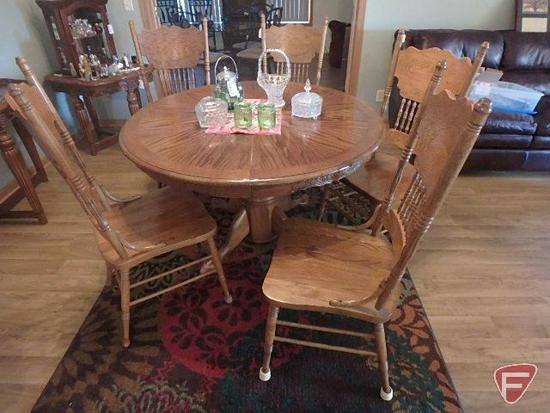 Round pedestal kitchen, claw foot like table with 5 ornate high back chairs