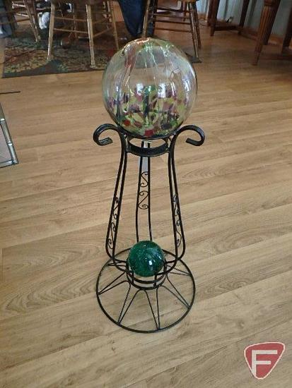 Gazing ball stand with glass ornament and green glass ball paperweight