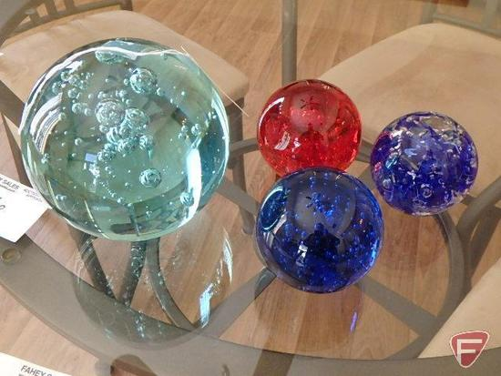 4 glass ball paperweights of various sizes