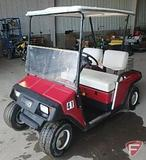 EZ-GO electric 2-seat red golf car with headlights, canopy, windshield, horn, model D2093