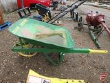 Metal wheelbarrow painted JD/John Deere green with steel wheel, broken handle