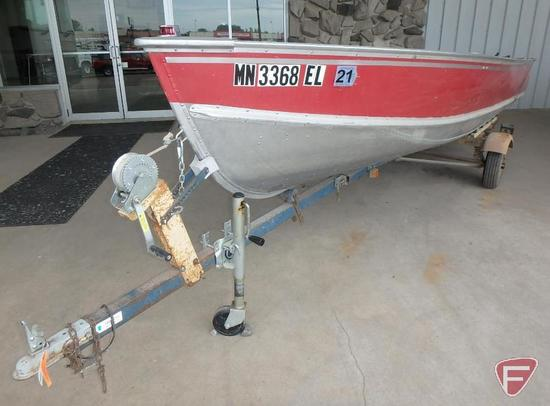 1982 16' Aluminum Lund Boat, Johnson 15HP Motor, Minkota trolling motor, and 1976 Holsclaw Trailer