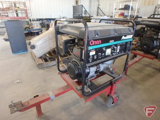 Onan Pro6000E gas generator on pull type cart, AC120v, 50amp