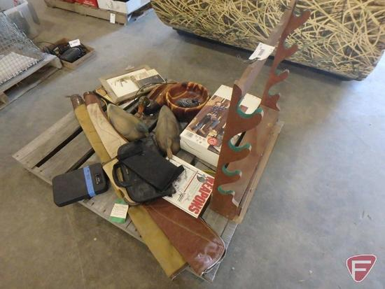 Wood gun rack, gun cases, small firearm safe, wood bowl, rubber decoys, picture, and shoe dryer