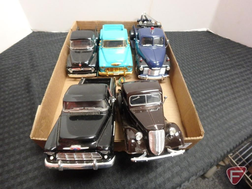 Chevrolet tow truck and other assorted pickups