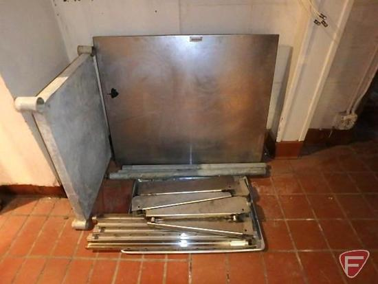 Stainless steel table with legs, stainless steel brackets, and full size baking pan
