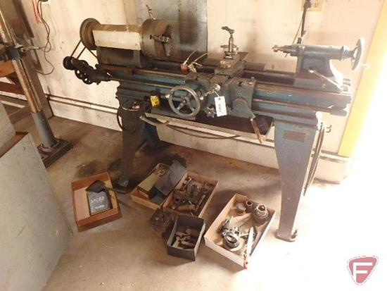 """South Bend lathe on cast iron stand, 3 jaw chuck, 28"""" from chuck to live center,"""