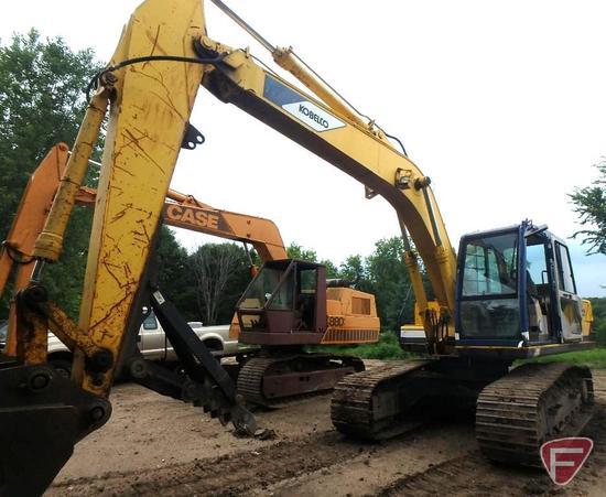 """Kobelco Mark III SK150LC excavator with 36"""" Kobelco grapple bucket with teeth, 7448 hrs showing,"""