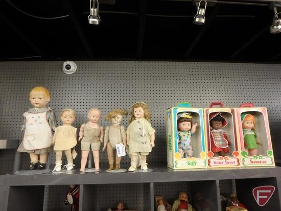 Vintage dolls with stands, tallest is 18in, and Original Eugene Dolls in boxes, Taffy, Bitter Sweet,