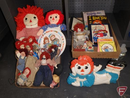Collection of Raggedy Ann and Andy dolls, books, and decorative items.