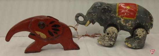Vintage cast iron elephant nutcracker and vintage wood elephant pull along toy with moving legs.