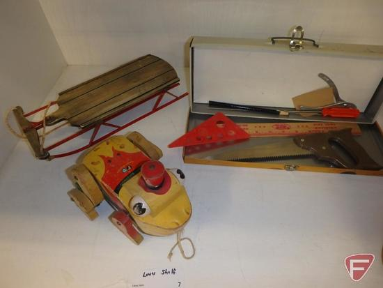 Vintage toys, pull-behind wood train pieces, red engine is 9in long, metal tool chest with tools,