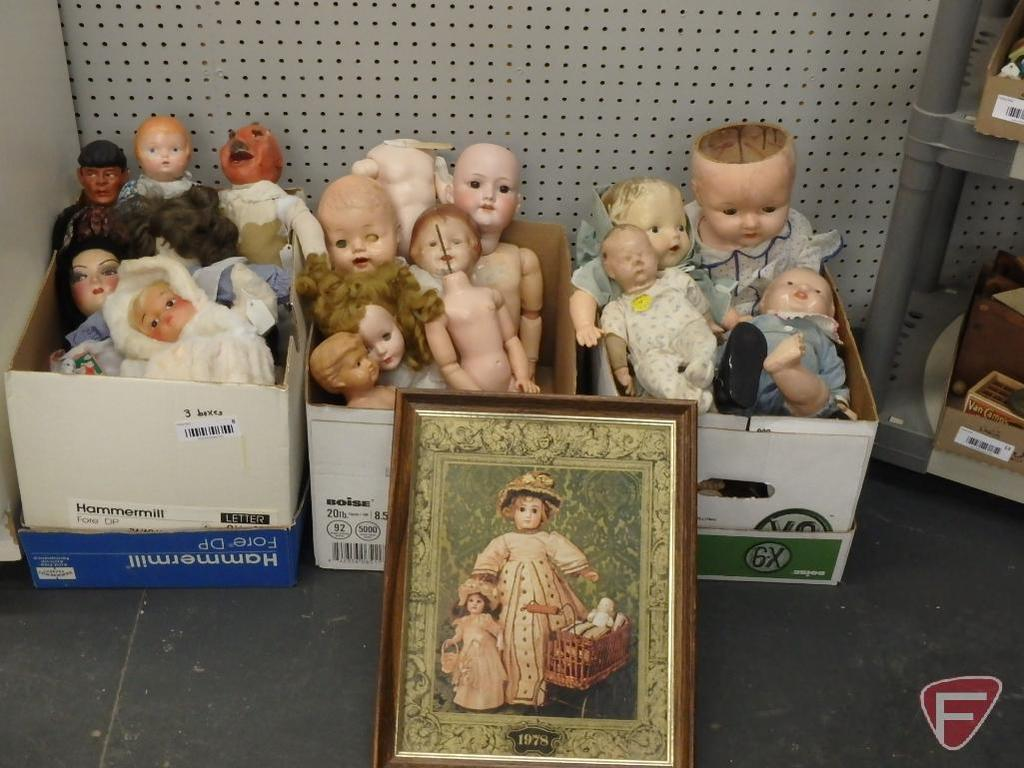 Assortment of dolls and doll parts, some vintage, porcelain and plastic, and framed doll print.