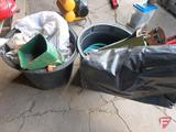 Grass seed, Scotts hand seeder, partial roll of black poly plastic, garden hose, sump pump,