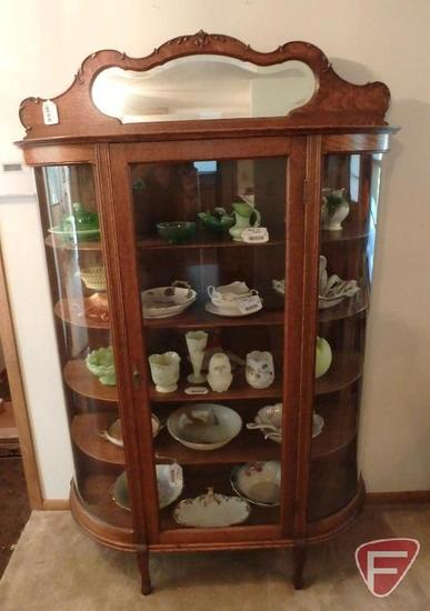 Vintage wood and glass curio cabinet, 4 wood shelves, one glass door, mirror top
