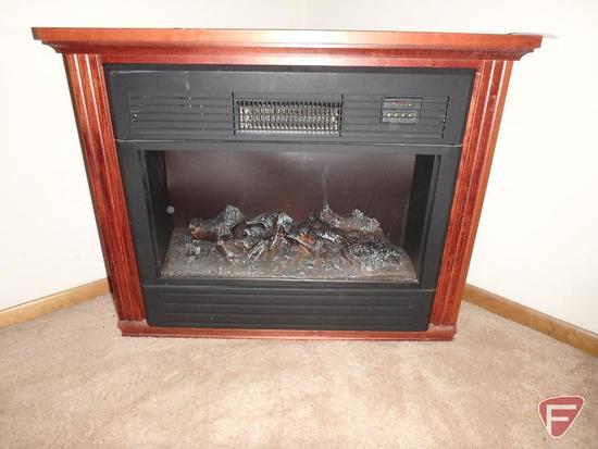 Heat Surge electric fireplace with mantle hand made by Amish craftsman, on wheels