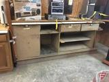 Bank teller's cabinet, used as workbench, 8' wide
