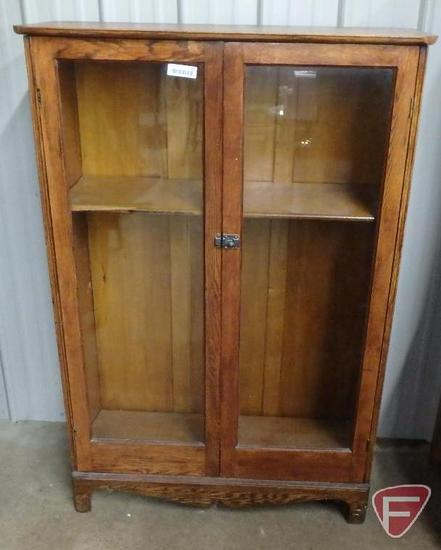 Wood bookcase with glass doors, wood shelves, 57inHx38inWx14inD.